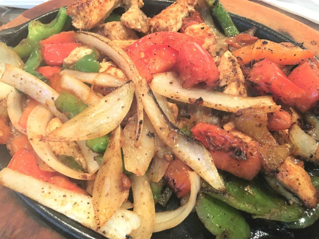 Sizzling Peppers, Onion, Tomatoes, and Chicken for Fajitas