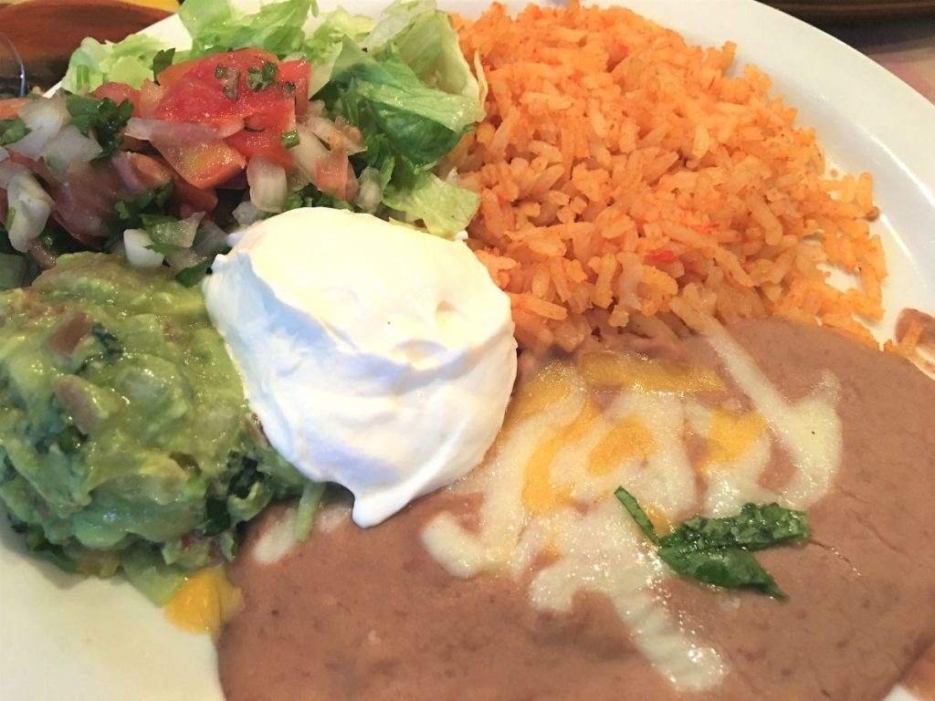 Fajitas Side Cold Plate includes seasoned rice, guacamole, pico de gallo, lettuce, refried beans and sour cream