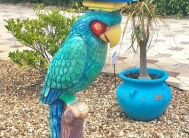 Colorful parrot mailbox in Fort Myers Beach, Florida