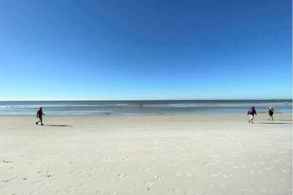 The beach has grown at low tide